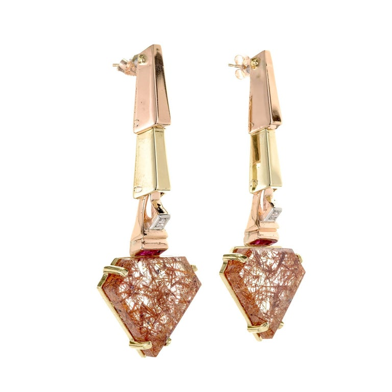 Retro 1935-1940 pink and green gold dangle earrings of angular design with pink gold top links, green gold second links and channel set Rubies and old European cut diamonds at top gem grade. Rutilated Quartz bottoms. A wonderful Retro jewel.