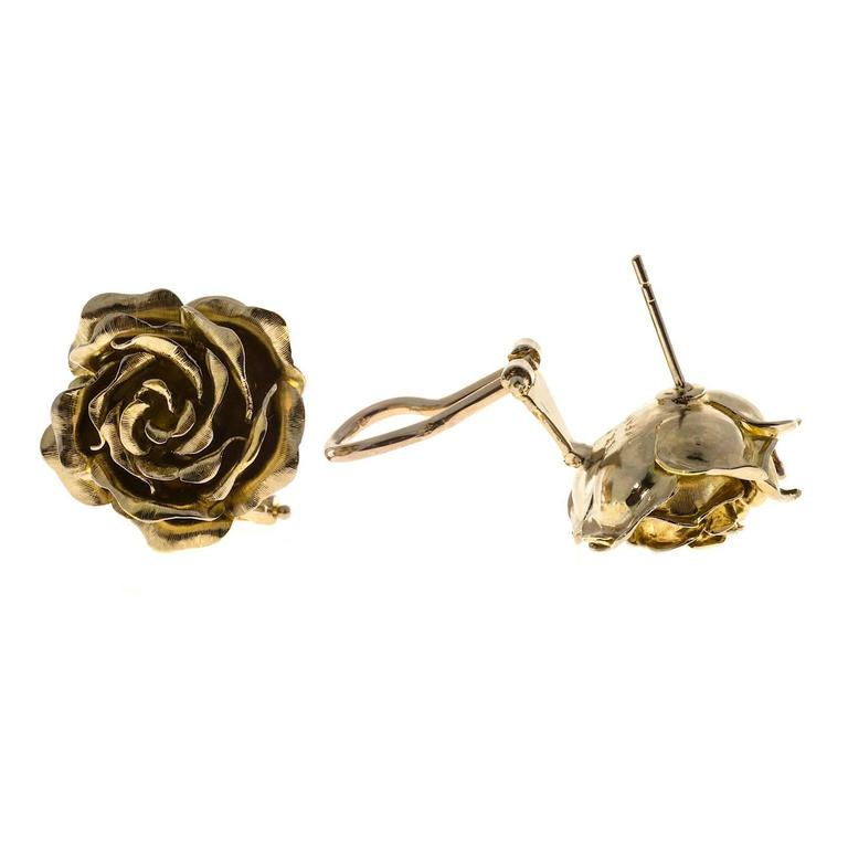 1950 green gold 3-D flower earrings made in Italy for Tiffany & Co.   18k Green Gold Stamped: 18k Italy Tiffany + Co 16.8 grams Width: 21mm or .83 inches Depth: .42 inch or 10.7mm Clip and post style Flower petals have some movement