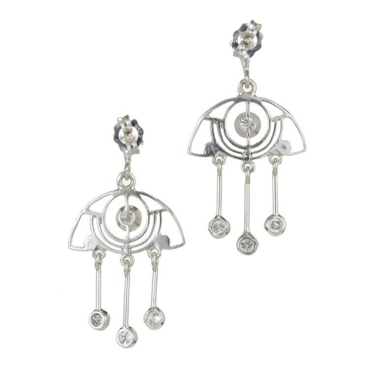 Artistically designed open work diamond dangle chandelier earrings with quality full cut diamonds.  10 brilliant cut diamonds, approx. total weight .64cts, F-G, VS Platinum 4.1 grams Tested: Platinum Stamped: 950 on earrings back Top to bottom: