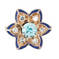 Blue Zircon Diamond Black Enamel Yellow Gold Flower Cocktail Ring