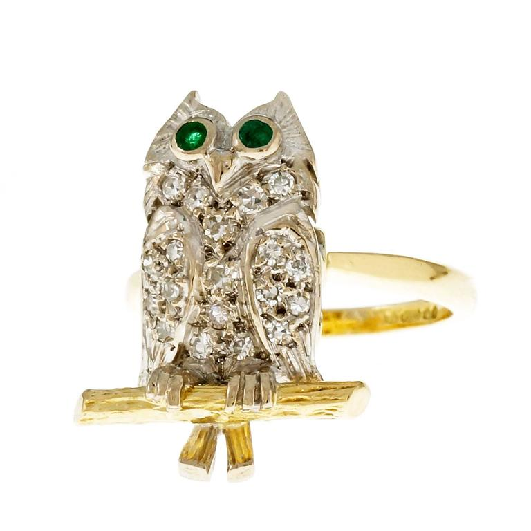 18k yellow and white gold Owl ring with Diamond pave body and genuine Emerald eyes. Signed JHL.  19 round single cut Diamonds, approx. total weight .25cts, H, VS – SI 2 round green Emeralds, approx. total weight .08cts, 2mm 18k yellow and white