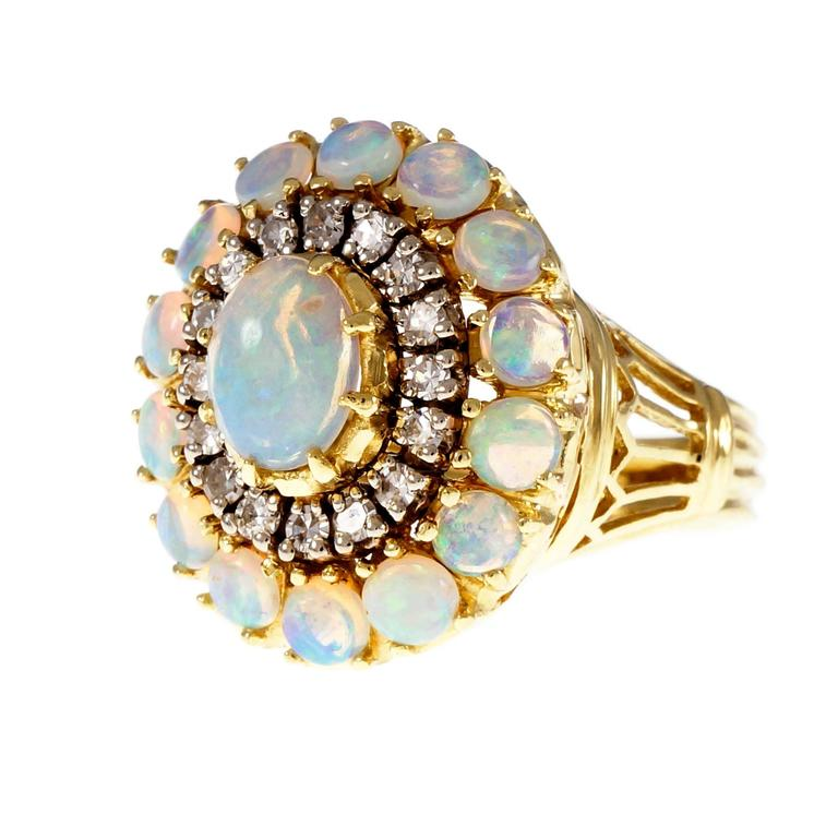 1950's 18k yellow gold domed cocktail ring with top gem blue green Opals and  full cut Diamonds.  1 oval cabochon blue green translucent Opal, approx. total weight .75cts, 7.75 x 5.84mm 16 round Diamonds, approx. total weight .33cts, H, SI1 14 round