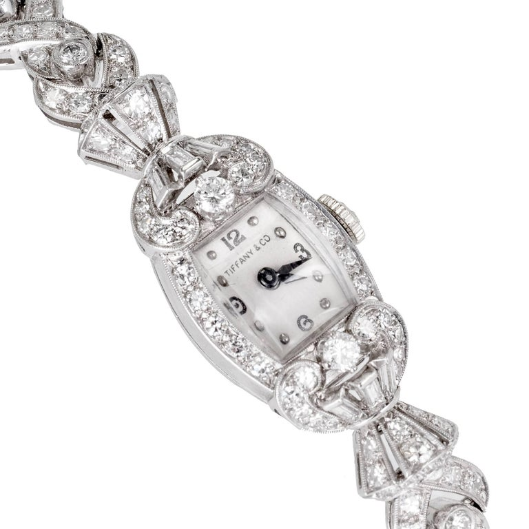 Hamilton lady's platinum and diamond bracelet wristwatch, circa 1940s. Round and baguette diamonds set in platinum.   151 round diamonds 2.30cts, F to G color, VS.  6 baguette cut diamonds 0.15cts, F, VS.  12 round diamonds are full cut the rest are