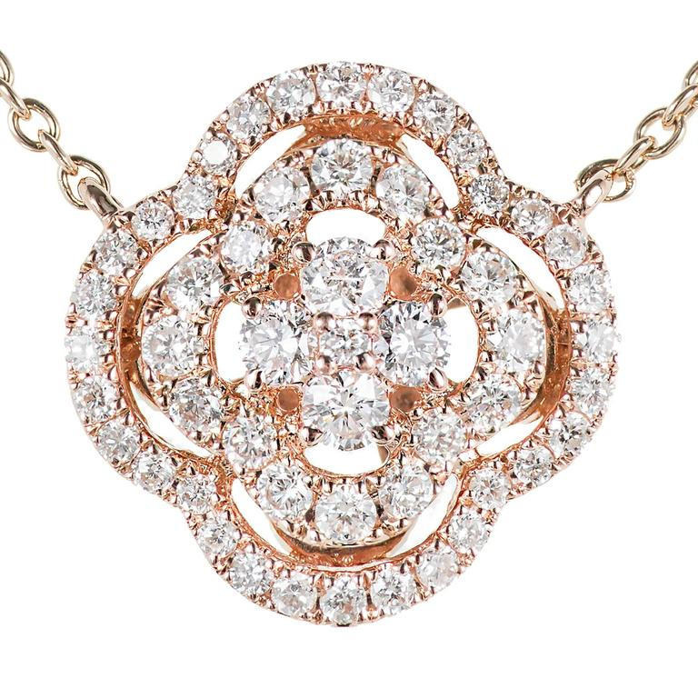 Three section Diamond cluster pendant necklace in 14k rose gold with bright white full cut Diamonds.  67 round full cut Diamonds, approx. total weight .63cts, G, SI1 14k rose gold Tested: 14k Stamped: 585 3.4 grams Length: 16 inches – Width: .70mm –