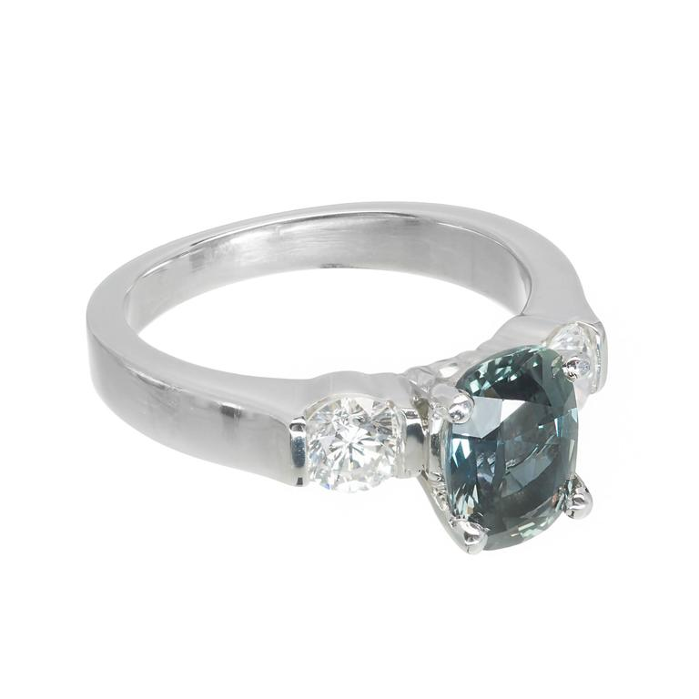 Natural GIA certified color change Sapphire engagement ring. The center stone changes color in different lights from green blue to grey purple. No heat and no enhancements. Solid Platinum setting with bright sparkly brilliant cut Diamonds.  1