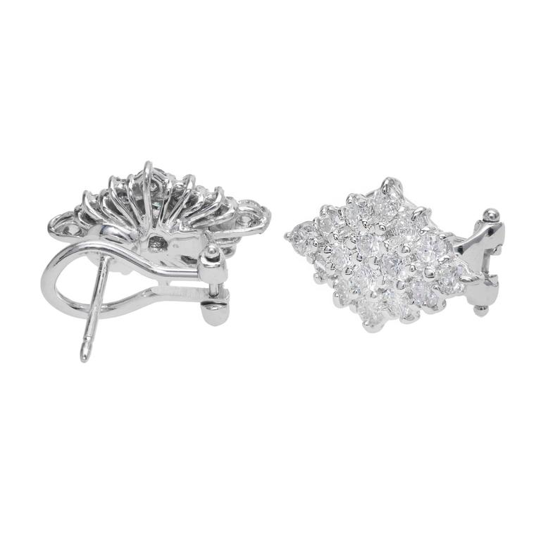 Handmade wire Marquise shaped clip post earrings with bright white sparkly Diamonds.   32 round Diamonds, approx. total weight 2.00cts, F, SI1 – SI2 14k white gold Tested: 14k Stamped: 585 Hallmark: * 7.4 grams Top to bottom: 18.22mm or .72