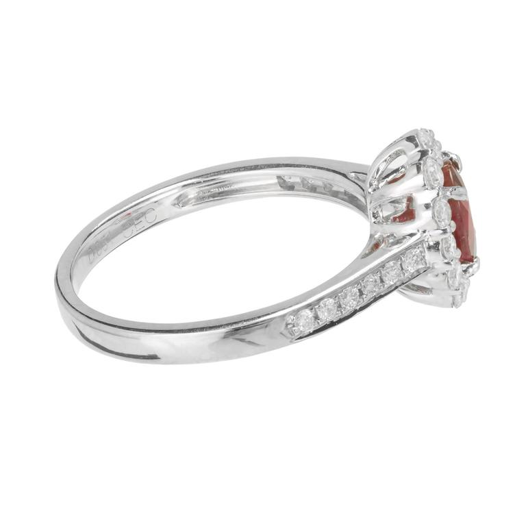 Women's .88 Carat Oval Ruby Diamond Halo Gold Engagement Ring For Sale