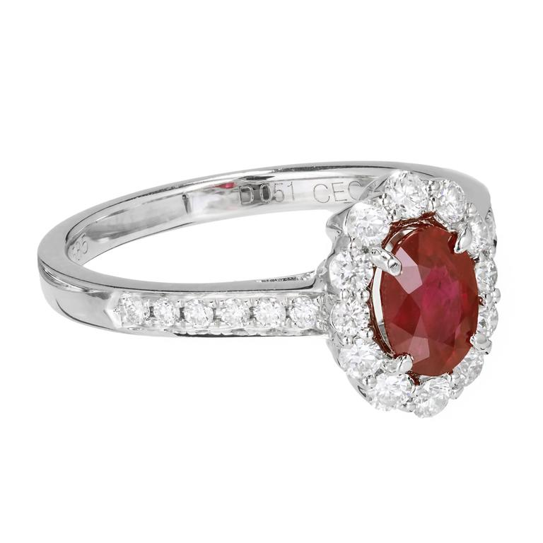 .88 Carat Oval Ruby Diamond Halo Gold Engagement Ring In Good Condition For Sale In Stamford, CT