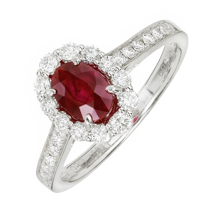 Oval Ruby Diamond halo 14k white gold engagement ring.  1 oval red Ruby, approx. total weight .88cts 24 round full cut Diamonds, approx. total weight .51cts, G, VS 14k white gold Tested: 14k Stamped: 14k 585 3.0 grams Width at top: 11.19mm Height at