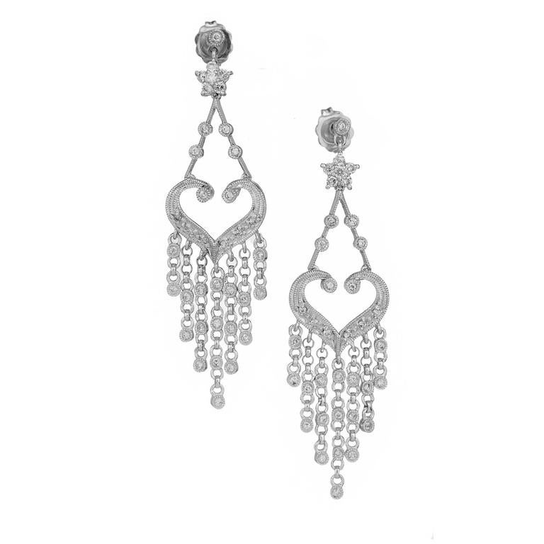 Chandelier style dangle earrings with full cut Diamonds in 14k white gold.  74 round Diamonds, approx. total weight .58cts, H, SI1 14k white gold 6.4 grams Tested: 14k Stamped: 585 Hallmark: 029 Top to bottom: 50.85mm or 2.0 inches Width: 13.70mm or