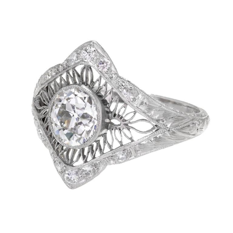 All original Edwardian Platinum engagement ring circa 1910 with beautiful old mine brilliant cut sparkly Diamond. Delicate open work with Diamond accents.  1 old mine brilliant cut Diamond, approx. total weight 1.02cts, I, VS2, GIA certificate
