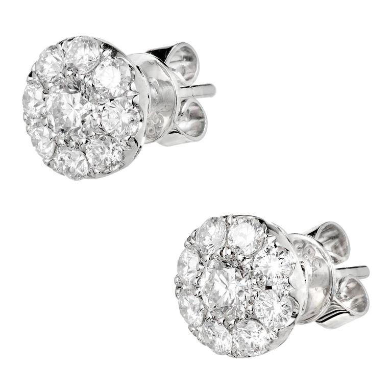 Round Diamond cluster earrings with bright white brilliant cut Diamonds, in 14k white gold.  2 round full cut Diamonds, approx. total weight .33cts, G, VS – SI 16 round full cut Diamonds, approx. total weight .90cts, G, VS – SI 14k white gold 1.9