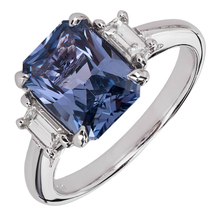 Peter Suchy rectangular brilliant cut fine bright periwinkle blue natural no heat Sapphire engagement ring, 2.56cts. GIA certified untreated center stone of purplish blue bright color. Accented with two baguette diamonds in a platinum setting.   1