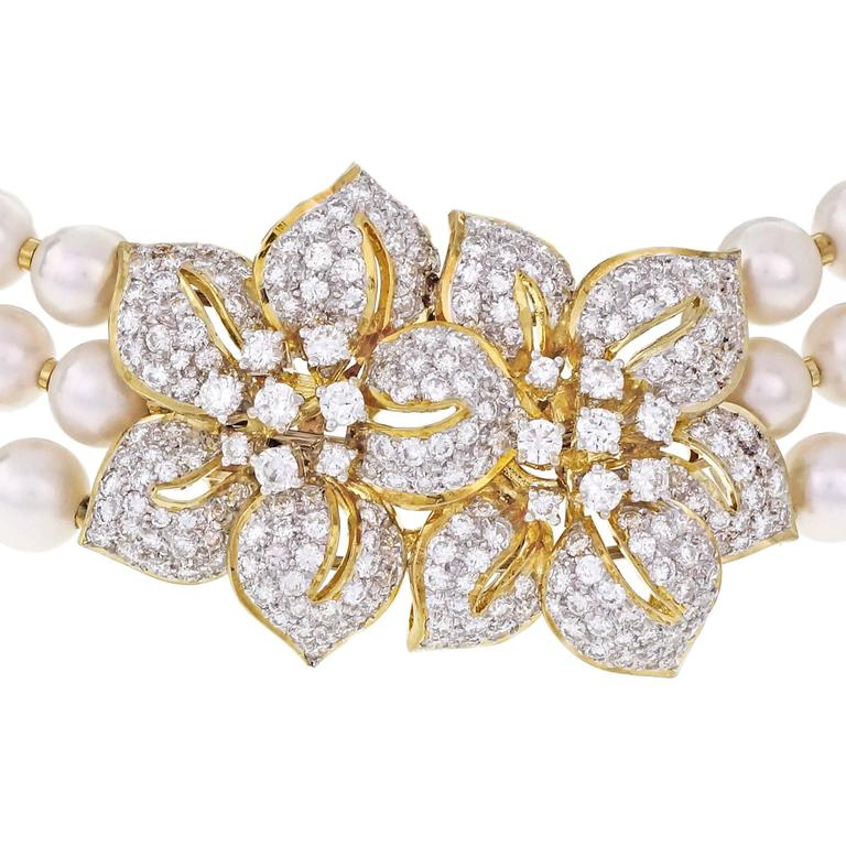 Custom made 3 row pearl and diamond choker necklace collar in 18k yellow gold with secure 18k white gold spring and white gold wire with 3 rows end to end for a firm secure tapered fit for a 15 to 17-inch neck. 18k gold spacers between. vintage 1960