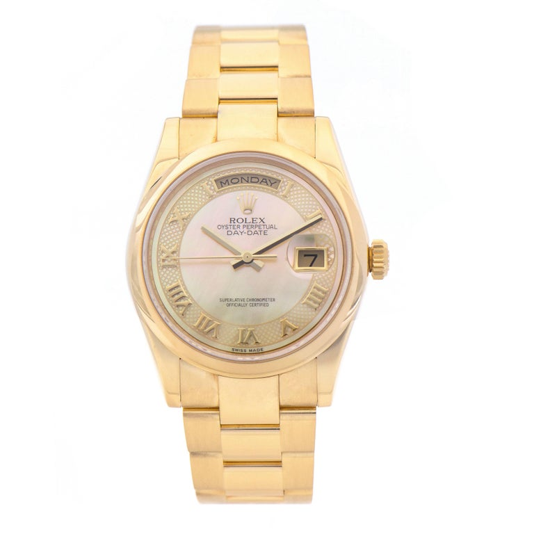 Rolex Day-Date President ref 118208 champagne mother of pearl deco roman dial with day and date functions.   Mother of pearl dial 36mm 18k yellow gold case Bezel Rolex domed 18k yellow gold Rolex 73208 18k yellow gold oyster band Rolex 3155 31 jewel