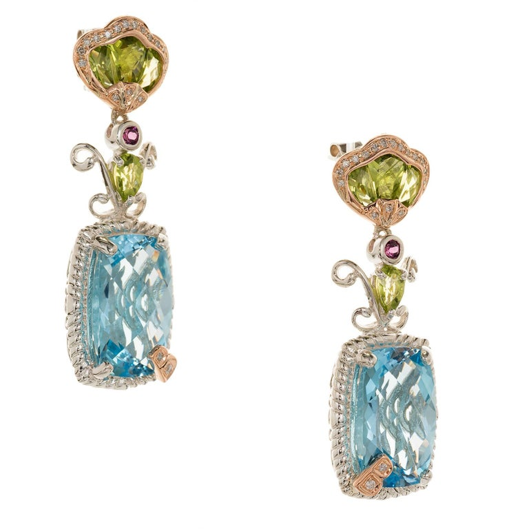 Bellarri silver and 18k rose gold dangle earrings with Peridot, diamond, blue Topaz and garnet Fully finished rear galleries.  2 blue Topaz, 15 x 11 rectangle, approx. total weight .22cts 8 custom cut Peridot, approx. total weight 1.20cts 38 round