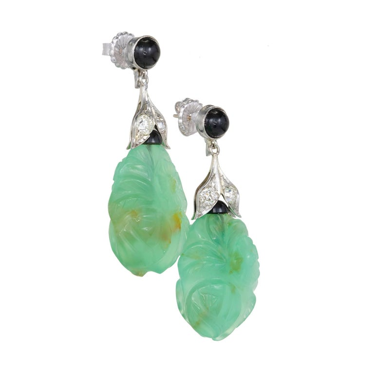 Original 1930's late Art Deco earrings with translucent carved Chalcedony accented by black Onyx and old European cut Diamonds.  2 carved green Chalcedony, 24.7 x 18.44 x 10mm, GIA certificate #6187474086 2 round cabochon black Onyx, 5.63mm 2 round