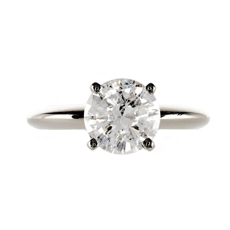 Transitional Ideal cut bright sparkly diamond solitaire engagement ring in a white gold setting.  EGL certified G color, I1 clarity (white feathers just eye visible),   1 round diamond, approx. total weight 1.77cts, G, I1, EGL certificate #
