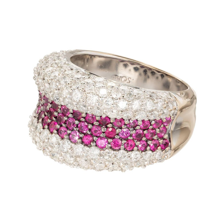 Authentic Sonia B cocktail ring. Three center rows of red Rubies with 5 rows of fine white diamonds on either side. The center is recessed. Both sides are domed. Solid 18k white gold.  120 round diamonds approx. total weight 2.40cts, F, VS 53 round