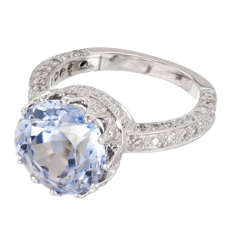 Peter Suchy vintage Inspired queens crown sapphire and diamond engagement ring. 18k white gold setting with Pavé set bright white full cut Diamond accents. The center Sapphire is from an estate circa 1910 in light periwinkle blue old European cut.
