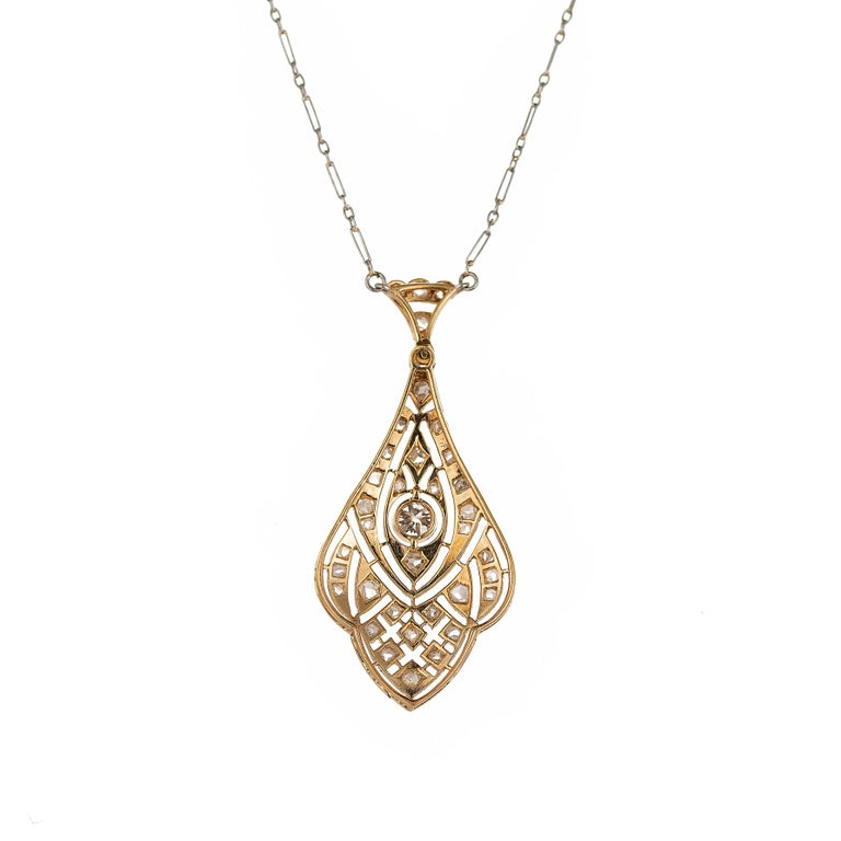Authentic Edwardian 1910 Platinum top,  14k gold handmade Diamond pendant necklace with original handmade platinum chain. Delicate open work, hand set with good rose cut and European cut diamonds.  1 old European diamond H SI approximate .17