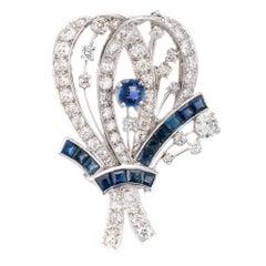 8.22 Carat Diamond Sapphire Platinum Flower Brooch, circa 1940s