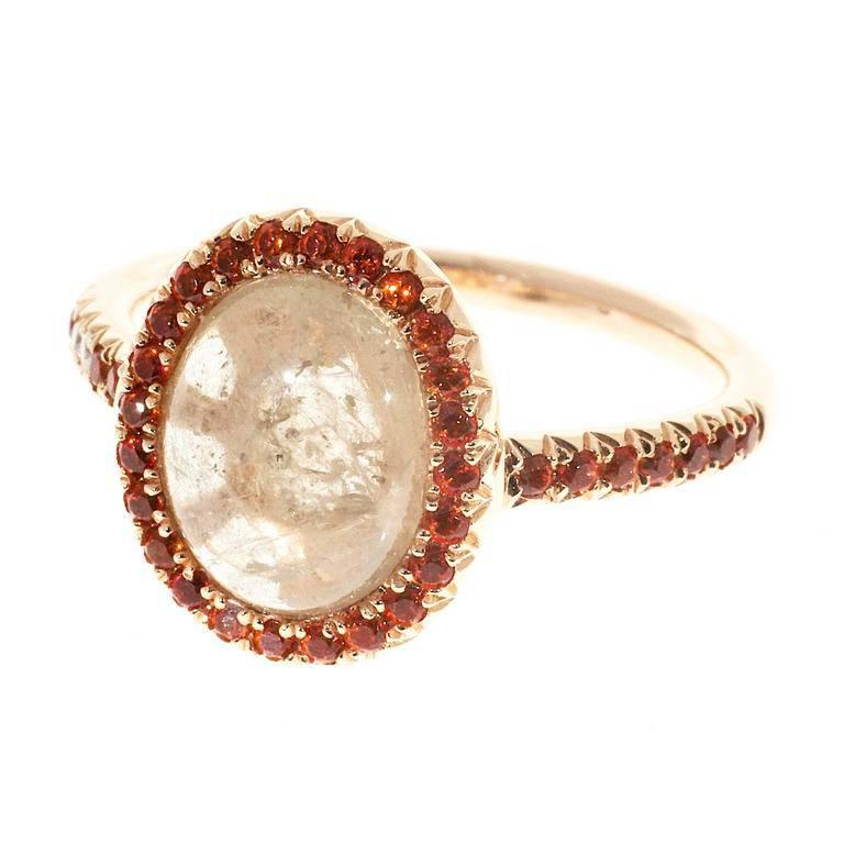 Natural untreated Sapphire engagement ring. Center stone surrounded by diamonds and orange Sapphires in a 18k rose gold setting.    36 round orange Sapphires, approx. total weight .40cts, simple heat only 2 round diamonds, approx. total weight