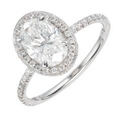 Certified 1.52 Carat Oval Diamond Halo Platinum Engagement Ring