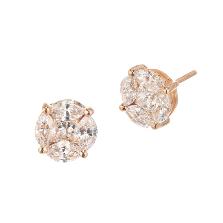 Marquise princess cut diamond cluster earrings in 18k rose gold   8 marquise cut G-H VS diamonds, Approximate 1.20 carats  2 princess cut G-H VS diamonds, Approximate .34 carats  18k Rose Gold  2.7 grams Stamped: DC 750 Hallmark: HK Top to Bottom: