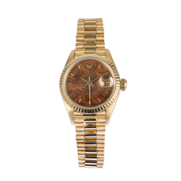 Ladies Rolex President 18k yellow gold wrist watch made in 1984. Fully serviced. One of a kind dial with a permanent yellowish color.  18k yellow gold  67.2 grams  Length: 6 3/8 inches  18k yellow gold  Length: 32.84mm  Width: 26mm  Band width at