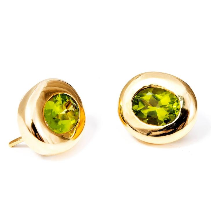 Oval Cut 4.10 Carat Oval Green Peridot Domed Gold Bezel Stud Earrings For Sale