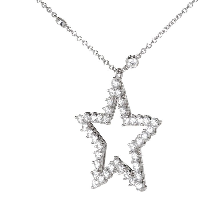 Tiffany & Co star design platinum pendant necklace. Tiffany 12 stone diamond by the yard necklace. With Tiffany box.   Pendant: 40 round diamonds, F, VS  approx 3.30cts Chain: 12 round diamonds, F, VS  approx 1.14ct  Diamonds total for pendant and