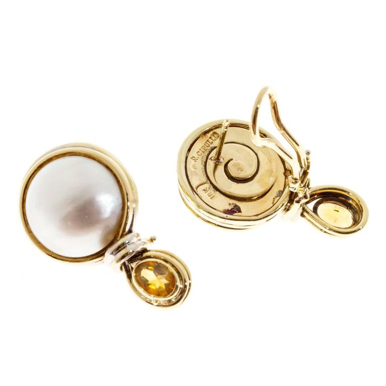 Authentic R Cipullo hand made 18k yellow and white gold earrings in clip post style set with silvery white Mobe pearls and genuine Citrines.   2 oval 6.5 x 4mm oval genuine Citrines,  1.00ct total weight 2 round 15mm Mobe pearls 18k Yellow