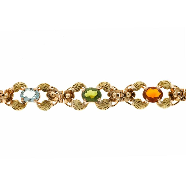 Handmade rose gold bracelet with textured green gold leaves and multi-color genuine stones. 14k Rose green gold. Circa 1940. 