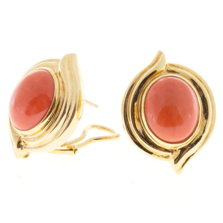 Certified natural reddish orange high polish untreated Coral in solid 18k earrings. Circa 1950-1960.