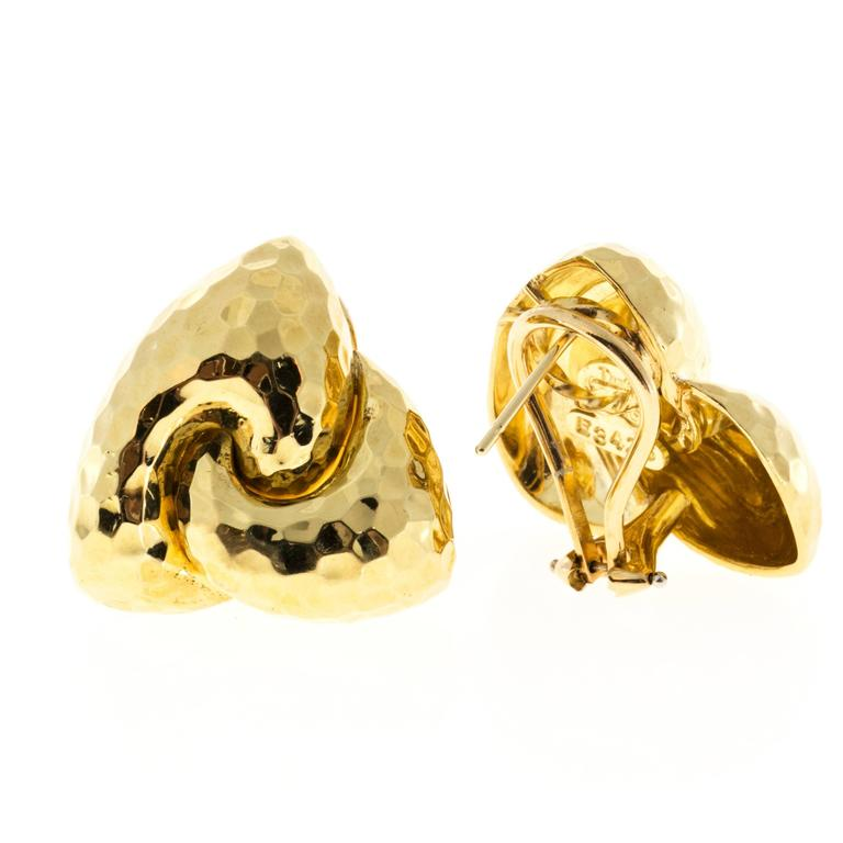 Hammered Henry Dunay clip post solid 18k earrings.