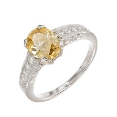 GIA Certified 1.07 Carat Oval Fancy Yellow Diamond Platinum Engagement Ring