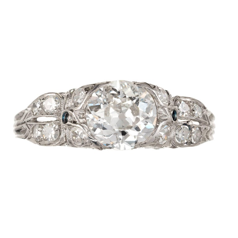 1900-1910 Edwardian Diamond Platinum engagement ring.   1 original old European cut, approx. total weight 1.17ct, G, VS1, 7.03 x 6.83 x 3.67mm, Depth: 52.9%  Table: 51.0%, good polish and symmetry, brilliance  12 single old cut diamonds, approx.