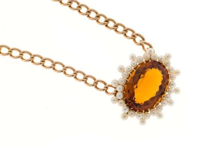 Handmade pink gold chain and wire pendant with fine pearls and incredible natural untreated orangey yellow Citrine. Circa 1900.  Oval genuine orangey Citrine Madera, approx. total weight 11.00cts, 18 x 13.5mm, natural color 38 2.2 to 2.5mm fine
