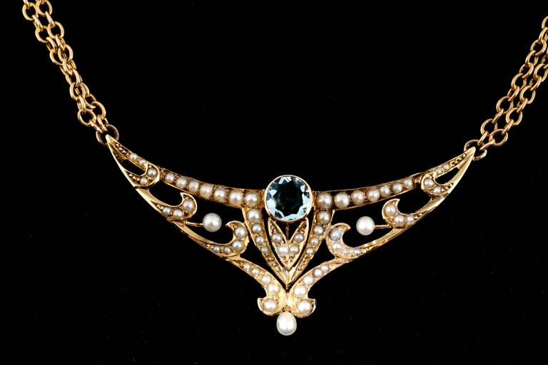 Handmade untreated Aquamarine natural pearl pendant and double chain. 18 ½ inch length. Circa 1890-1900  1 tear drop shaped pearl 1 round Aquamarine approx. total weight .75cts 44 seed pearls (2) 2mm natural pearls 14k Yellow Gold Stamped &
