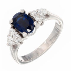 1.25 Carat Oval Sapphire White Diamond Gold Engagement Ring