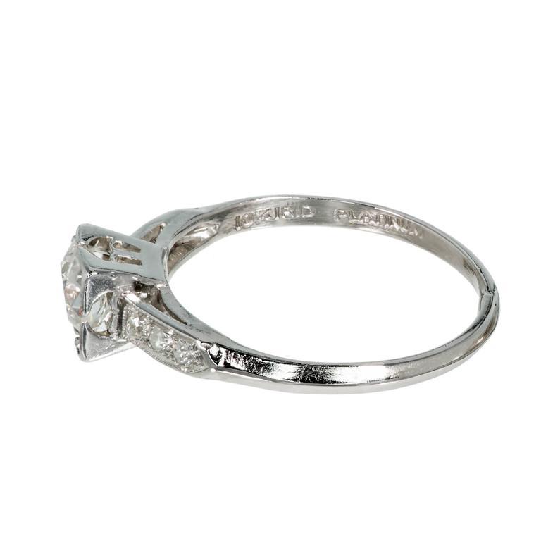 Original 1920's Art Deco solid Platinum handmade engagement ring with six side diamonds an old European Ideal cut center diamond. crt  1 Original old European cut center diamond .50ct, F to G color and SI1 clarity, Depth: 59.8%, Table: 56%, medium