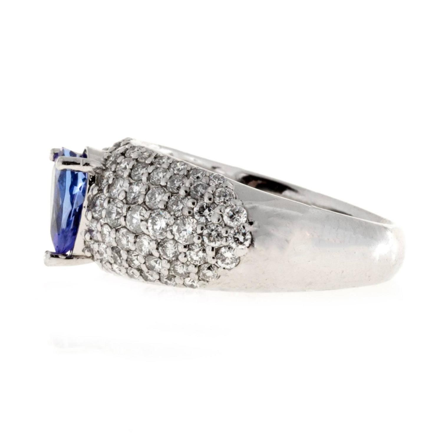 Pear Shaped Blue Tanzanite Bead Set Diamond Platinum Ring For Sale at 1stdibs