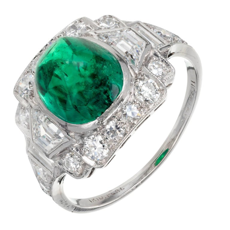 Original early 1900s Tiffany & Co Emerald and diamond Art Deco cocktail ring. Approx. 1910. Platinum setting with a high dome sugar loaf cabochon cut GIA certified natural Colombian Emerald and accent side diamonds.. Partially worn but readable