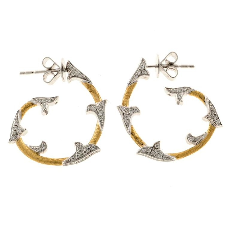 Cordova 18k white and yellow gold hoop earrings with post style tops.   190 round full cut diamonds, approx. total weight .63cts, F, VS 18k yellow and white gold Tested: 18k Stamped: 750 Stamped: Cordova 7.8 grams Top to bottom: 24.74mm or