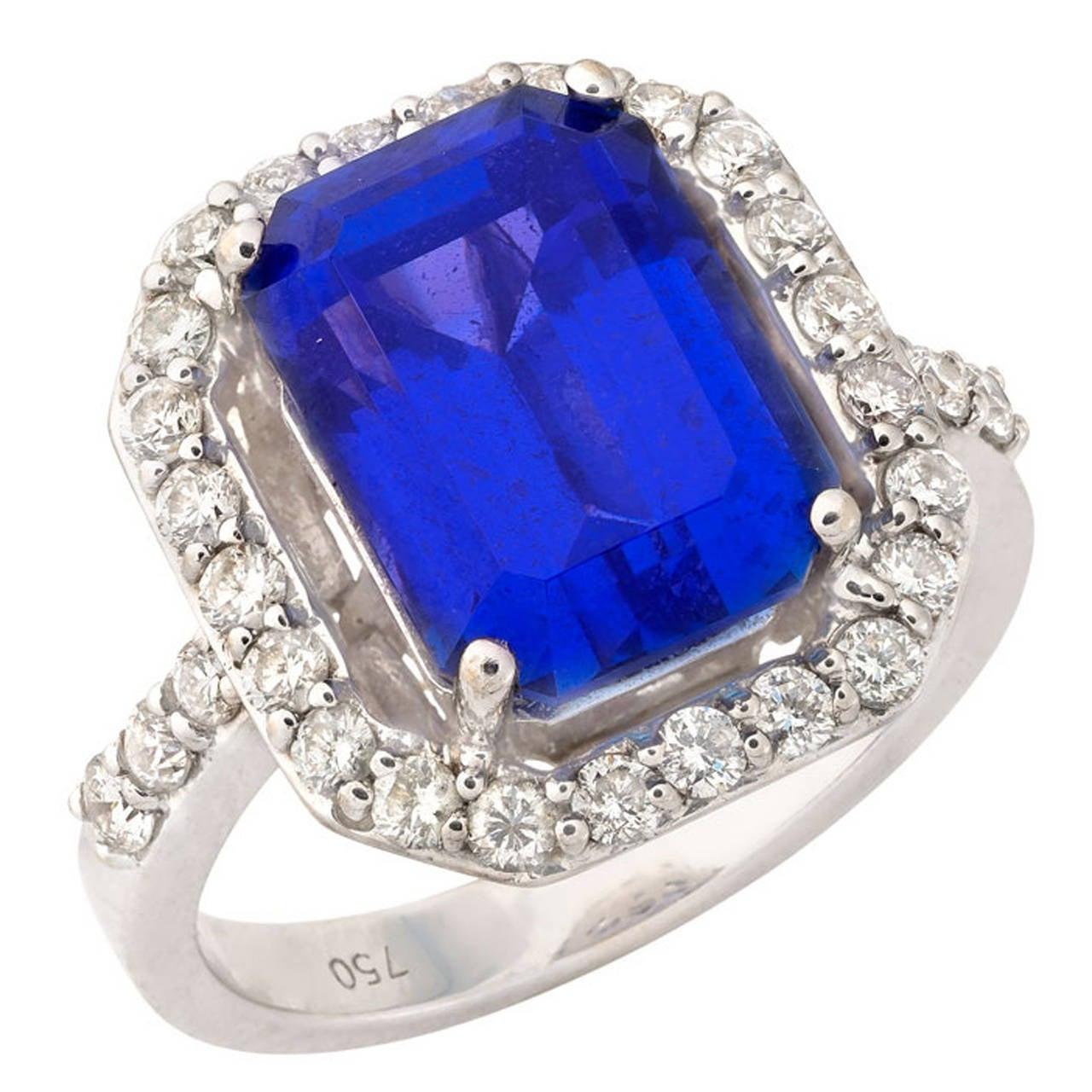 emerald cut tanzanite gold engagement ring