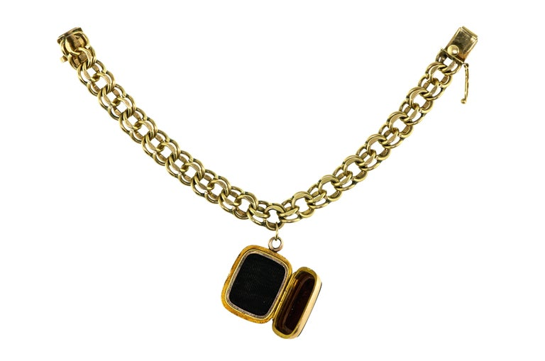 Exquisite vintage heavy 14k wide flexible yellow gold bracelet double link with 14k gold antique hardstone intaglio locket of