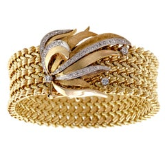 Beautiful 14 Karat Gold and Diamond Spray Wide Flexible Bracelet, circa 1970