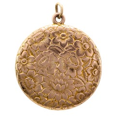 Pretty Antique Engraved Floral Round Yellow Gold Locket, circa 1900