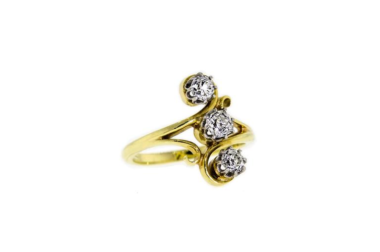 This lovely lady's, Art Nouveau, Circa 1900, 18kt yellow gold ring set with three dazzling (3) Old European Cut diamonds with an approximate total weight of 0.95 - 1.00cts is such an enchanting diamond ring.    Excellent clean Old European Cut